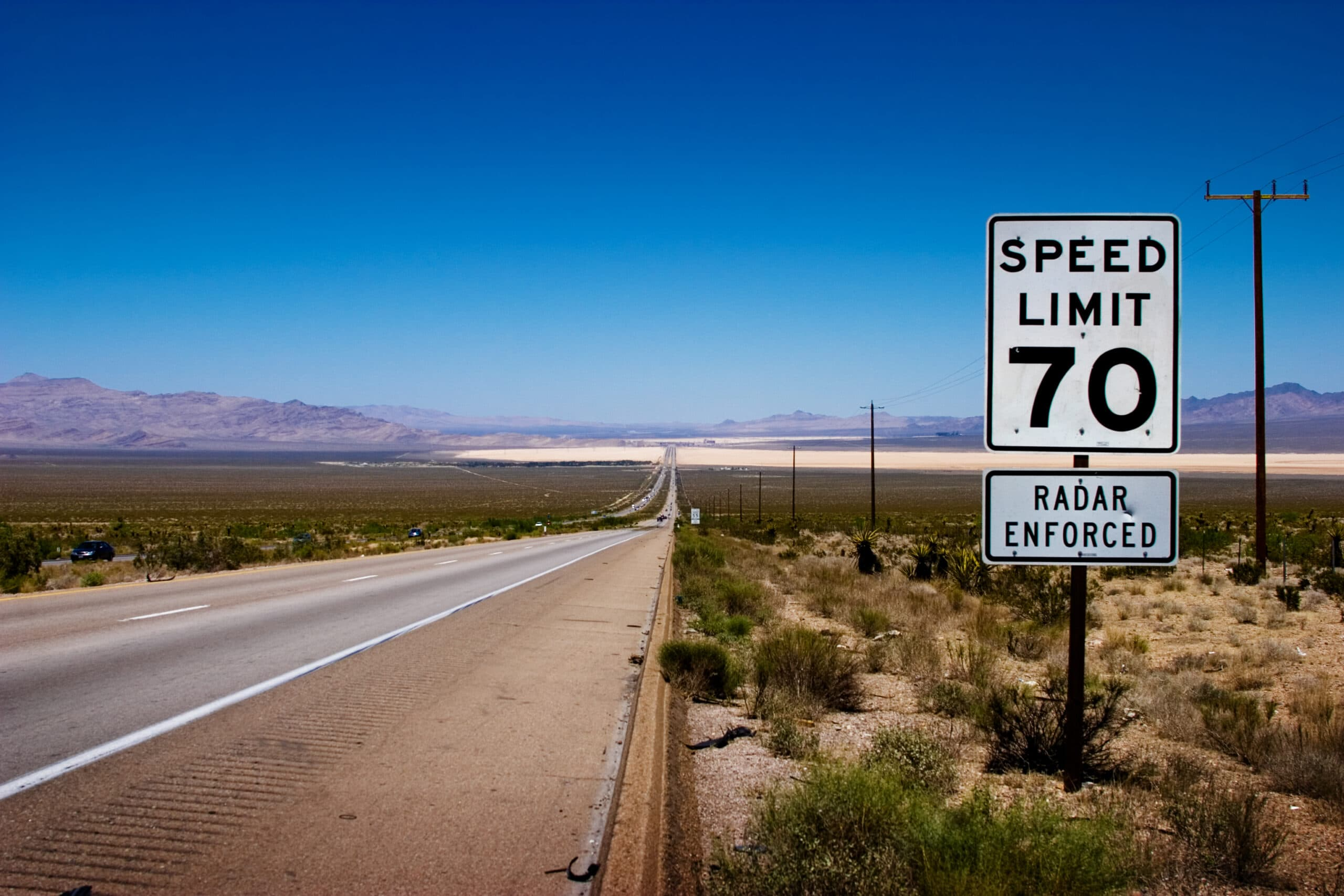 An open road in America with a radar-enforced speed limit of 70 mph.