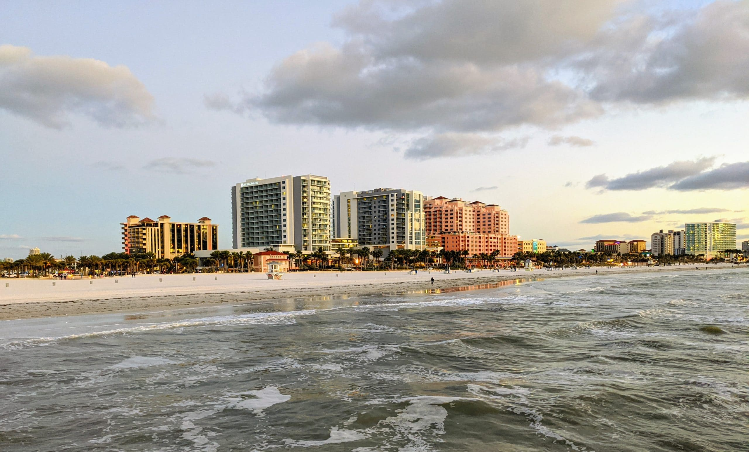High rise apartment buildings that are located by the beach.