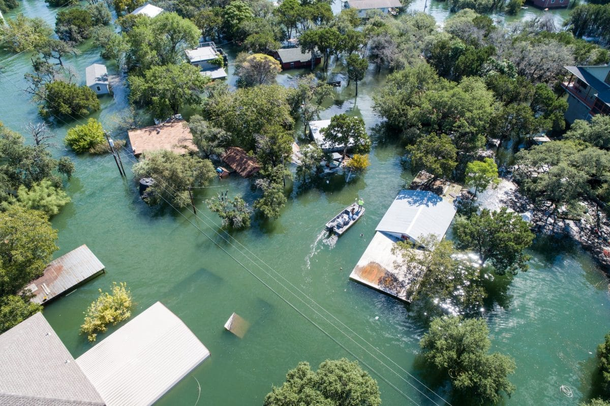 Natural disaster, flooding, leaves community submerged in its wake.