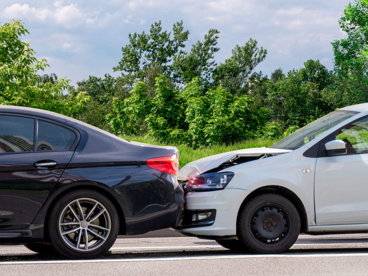A minor tailgating accident between two sedans.