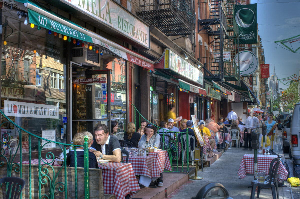 People enjoying lunch in Little Italy, New York City.